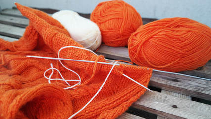 orange yarn for knitting on the table