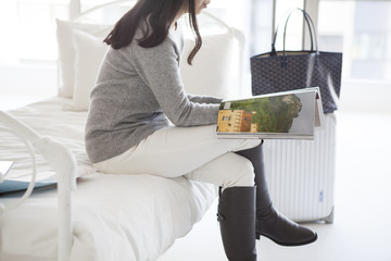 Women are reading a magazine in a hotel room