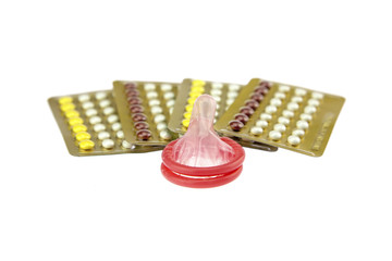 male condom and oral contraceptive., contraception education concept., isolated on white background.