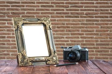 Vintage wooden picture frame on the desk.