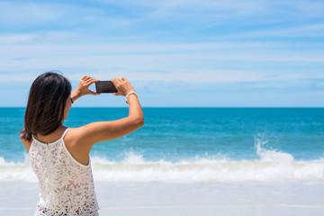 Travel asia woman taking photo