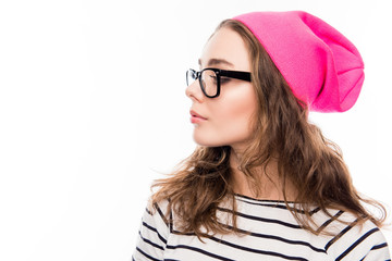 Side view portrait of cute girl in pink hat and glasses