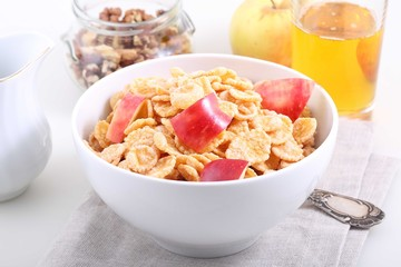 muesli with Apple pieces and Apple juice in a glass on white bac