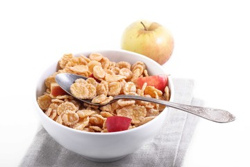 muesli with pieces of fresh Apple in a Cup on white background