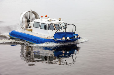 Hovercraft transporter at the Volga river in winter day