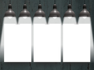Close-up of three hanged paper sheets with lamps on dark wooden background