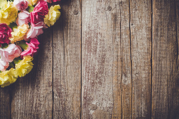 Carnation flowers on wooden table