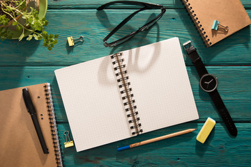 Open notepad and office supplies