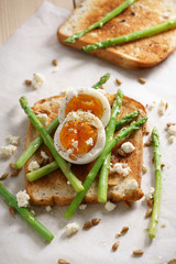 breakfast toast top with asparagus and soft boiled egg