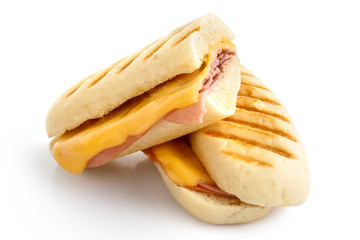 Cut cheese and ham toasted panini melt. Isolated on white.