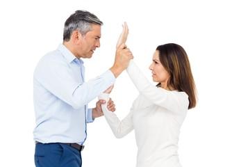 Violent man grabbing wifes wrists