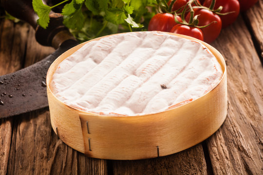 Delicious ripe French camembert cheese in a box