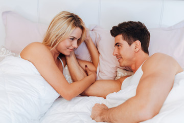 Couple in love lying on bed