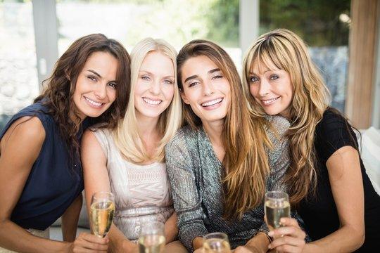 Portrait of beautiful women having drinks