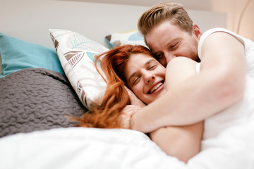 Beautiful couple in bed