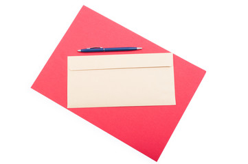 Classic envelop and pen on red background in top view