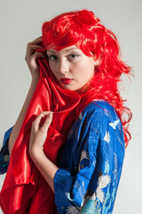 young lady with red hair and blue kimono