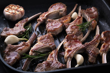 Grilled fresh lamb meat ribs with spices, garlic and rosemary