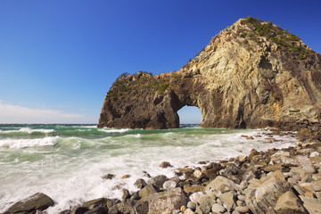 Natural arch on the rocky coastline of Izu Peninsula, Japan