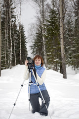 Female Photographer with Camera and Tripod