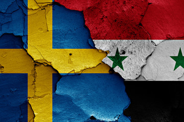 flags of Sweden and Syria painted on cracked wall