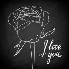 """Beautiful rose outline drawn on the blackboard with the text """"I love you"""""""