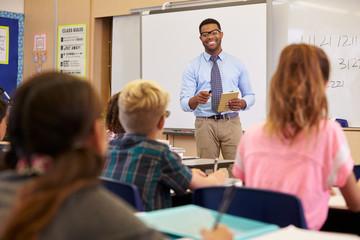 Teacher using tablet computer in an elementary school class
