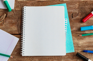 Notebook template mock up on a wooden table. Top view.