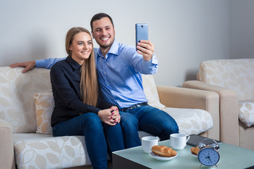 Beautiful young man and woman doing selfie with telephone camera