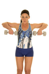 woman in blue fitness outfit pull weights
