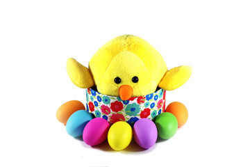 Yellow chick with colorful Easter eggs