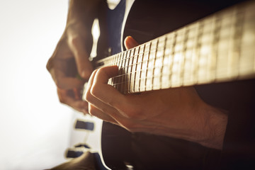 Men playing guitar close-up shot
