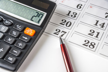 Calculator,Pen And Calendar on white background