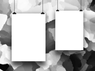 Close-up of two hanged paper sheets with clips on black and white out of focus painted background