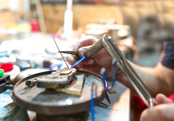 Focused brazing in progress at jewelry workshop