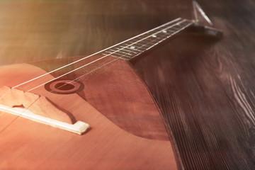 Folk musical instrument balalaika on wooden background