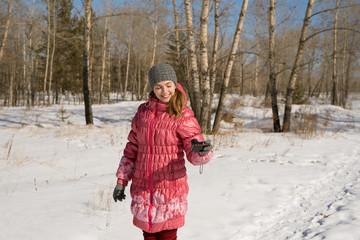 Woman in pink taking a winter selfie