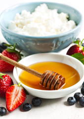 Honey, fresh berries and cottage cheese for healthy eating