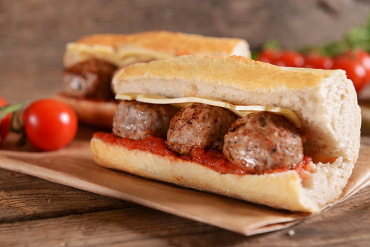 Sandwich with meat balls, cheese and sauce