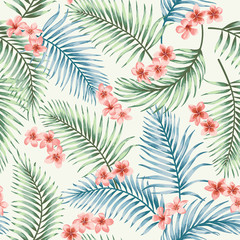 Seamless pattern with tropical leaves and flowers.