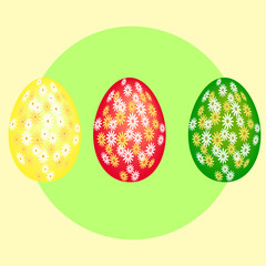 три крашенных яйца на фоне зеленого круга