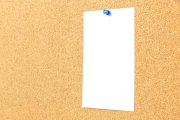 white blank paper on cork board