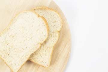 Place the bread on wood isolated white backdrop.