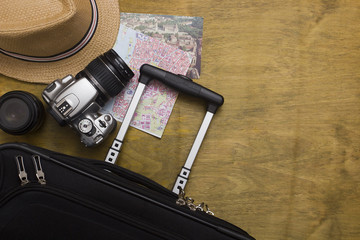 Traveler's suitcase with  equipment with camera and old pictur