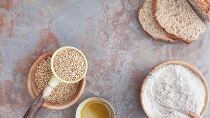 Buckwheat. Still life with buckwheat bread, flour and grains