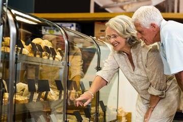 Senior couple pointing puddings