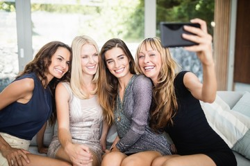 Beautiful women taking selfie with mobile phone