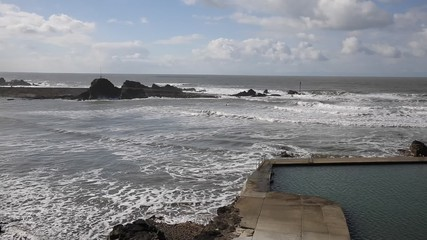 Fototapete - Bude North Cornwall UK windy day with waves and surfers pan