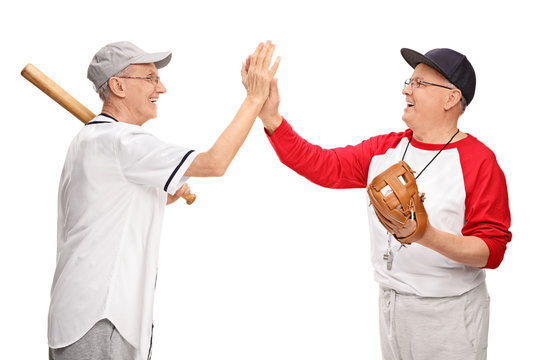 Senior men in sportswear high-five each other