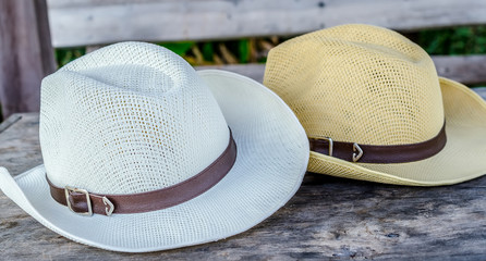 fedora hat over wooden table and wooden background